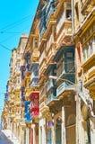 Hundreds of Maltese balconies, Valletta. The dense Maltese balconies on facade walls of old edifices in St Dominic street, Valletta, Malta Royalty Free Stock Photography