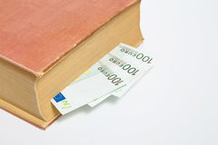 Hundreds od Euros in a book isolated. On white Royalty Free Stock Photography