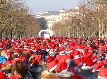 Hundreds of people dressed as Santa Claus during the foot race Stock Photos