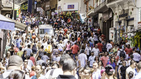 Hundreds of People walk along the 25 March area in Sao Paulo, Brazil Royalty Free Stock Image