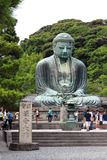 Hundreds of pilgrims, tourists and local people visit everyday the Daibutsu, the famous great bronze buddha statue in kamakura. Stock Photography