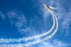 Hundreds plane. Hundred dollars plane on cloudy sky and trace Royalty Free Stock Image