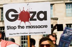 Protest messages on placards and posters at the Gaza: Stop The Massacre rally in Whitehall, London, UK. Hundreds of protesters with placards gathered for the Stock Image