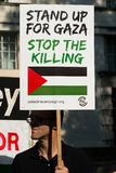 Protest messages on placards and posters at the Gaza: Stop The Massacre rally in Whitehall, London, UK. Hundreds of protesters with placards gathered for the Royalty Free Stock Photo