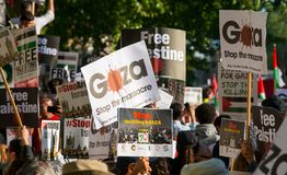 Protest messages on placards and posters at the Gaza: Stop The Massacre rally in Whitehall, London, UK. Hundreds of protesters with placards gathered for the Stock Photo