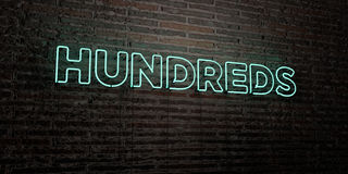 HUNDREDS -Realistic Neon Sign on Brick Wall background - 3D rendered royalty free stock image. Can be used for online banner ads and direct mailers Royalty Free Stock Images