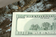 Hundreds of US dollars on old wooden background Stock Images
