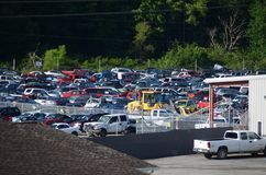 Used Car Junk Yard. Hundreds of used and damaged cars await destruction in a junk yard in West Virginia near the old town of Cass Stock Photo
