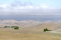 Wind farm in Livermore Golden Hill in California. Hundreds of wind turbines in wind farm in Livermore Golden Hill in California in the United States of America Royalty Free Stock Images