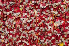 Wishing Wall. Hundreds of wishes and well meaning sentiments line a wall Royalty Free Stock Photography