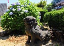 Hundstatyn på Wakamatsu parkerar Fotografering för Bildbyråer
