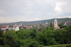 Town with church tower dominating houses. Hunedoara town seen from the castle stock photos