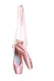 Hung ballet shoes. Hanging pink ballet shoes isolated on a white background stock photography