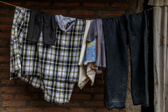 Hung clothes drying outdoors Royalty Free Stock Images