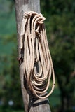 Hung rope close-up. Detail of a rope hung on a post Royalty Free Stock Photography