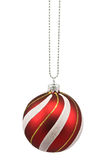Hung striped christmas bauble Royalty Free Stock Images