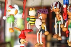 Hung wooden cartoon dolls Royalty Free Stock Photos