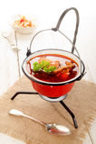 Hungarian carp soup in a kettle and sour salad stock photo