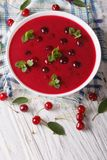 Hungarian cherry cream soup in a bowl vertical top view Stock Photography