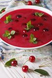Hungarian cold cherry soup in a bowl  close-up. vertical Royalty Free Stock Photography