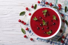 Hungarian cold cherry soup on the table. Horizontal top view Royalty Free Stock Photos
