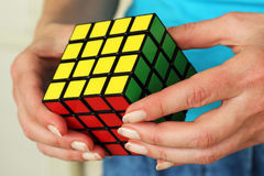 Hungarian cube, in the hands. Royalty Free Stock Image