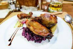 Hungarian cuisine, goose legs with red cabbage Royalty Free Stock Photography