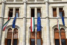 Hungarian and European Union flags. On the wall of the parliament building, Budapest, Hungary Royalty Free Stock Photos