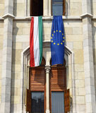 Hungarian and European Union flags in the window of the parliament building, Budapest Royalty Free Stock Image