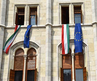 Hungarian and European Union flags in the window of the parliament building, Budapest Stock Images