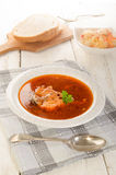 Hungarian fish soup in a soup plate, salad and bread Stock Photos