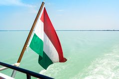 Hungarian flag at the cruise ship with bright light blue water o. F Balaton lake at the background Hungary Stock Photography