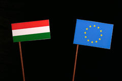 Hungarian flag with European Union EU flag isolated on black. Background Royalty Free Stock Images