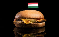 Hungarian flag on top of hamburger isolated on black Stock Image