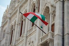 Hungarian flag on the wall of Hungarian Parliament Stock Photo