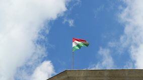 Hungarian flag. The Hungarian flag wavingwith the sky on the background stock video