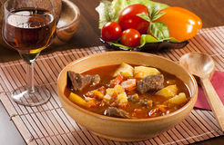 Hungarian goulash. Goulash with stewed beef, potatoes, red pepper and other spices Royalty Free Stock Photo