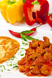 Hungarian goulash with potato pancakes Royalty Free Stock Image
