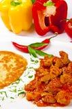 Hungarian goulash with potato pancakes Royalty Free Stock Image