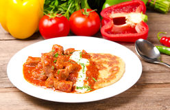 Hungarian goulash with potato pancakes Royalty Free Stock Photo