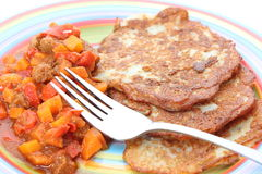 Hungarian goulash and potato pancakes stock image