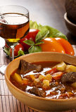 Hungarian goulash still-life. Goulash with beef, potatoes and red pepper stock photo