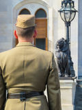 Hungarian guard standing on a check-post against the Hungarian Parliament building Royalty Free Stock Images