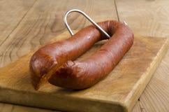 Hungarian kolbasz on a butchers hook Stock Image