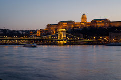 Hungarian landmarks, Chain Bridge, Royal Palace and Danube river in Budapest at night. Royalty Free Stock Images