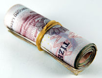 Money roll. Hungarian money roll with yellow rubber belt Stock Image