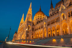 Hungarian Parlament at evening from the street. With lighttrails of the traffic Royalty Free Stock Photography