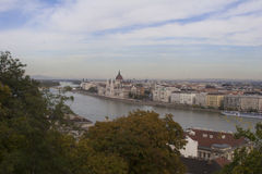 Hungarian Parliament from Buda Hill. Panoramic shot of the Parliament in Budapest from the hilltop across the Danube River Royalty Free Stock Photography