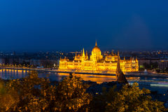 Hungarian Parliament in Budapest across the Danube Royalty Free Stock Images