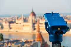Hungarian Parliament in Budapest across the Danube and Telescope Royalty Free Stock Images